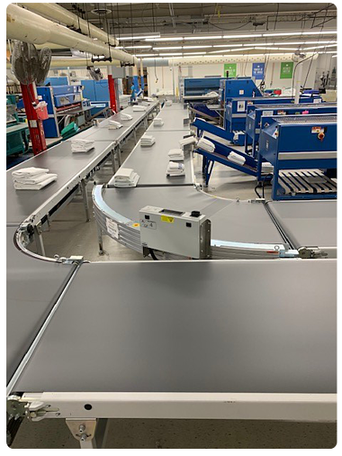 Within the last six months our Goodwill Laundry operation installed a full conveyor system to not only better manage our work flow but also lessen the strain on our employees.