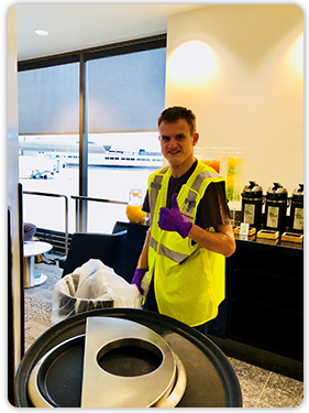 Anthony changes the trash bins in the Delta Sky Lounge where he and his family have been members for years. A coworker found purple gloves for him — his favorite color