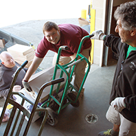 Trevor was learning how to use the pallet jack with assistance from Shawn his manager.