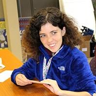 Terra helps to stuff envelopes at her internship